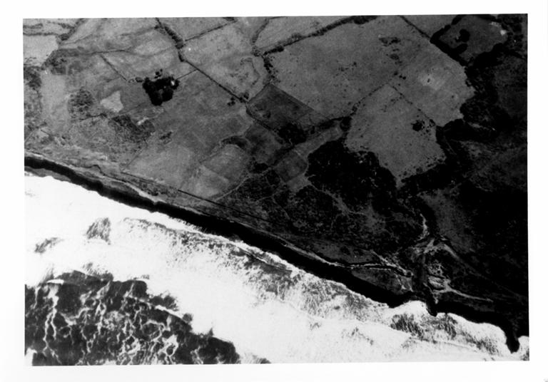 Aerial photo showing fresh cliff cut by tsunami waves
