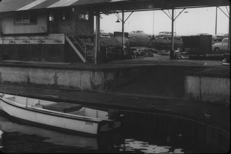 Tsunami damage at dock in Waiakea town