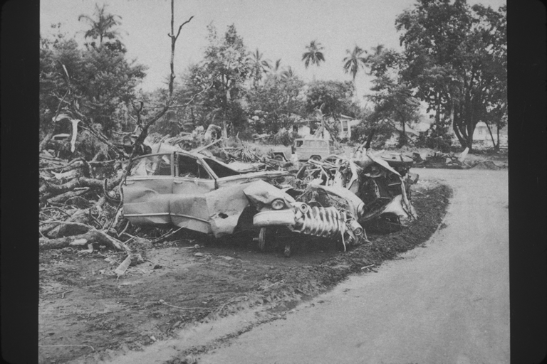 Wrecked automobile strewn with debris from tsunami in Hilo