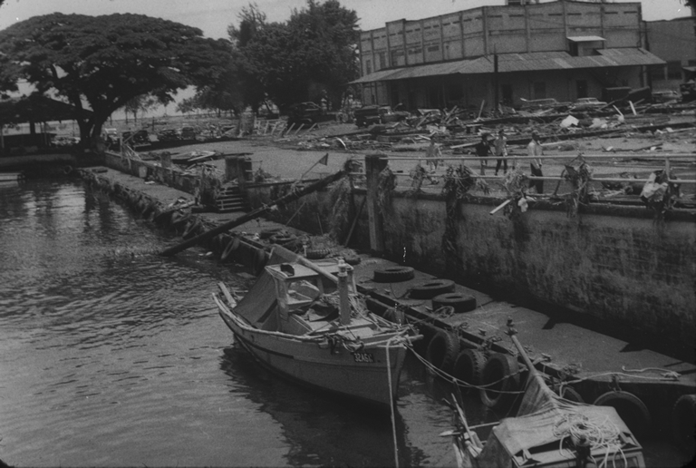 Wreckage and debris along waterfront in Hilo