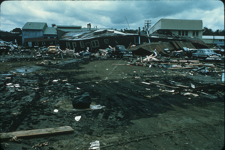 Structural damage and debris left from waves in Hilo