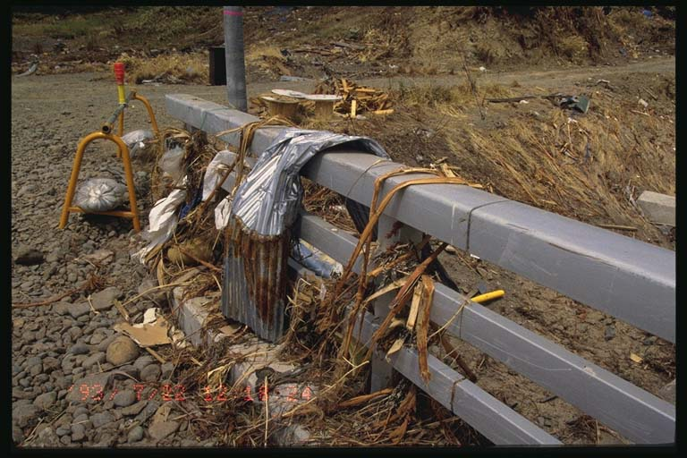 Debris on highway overpass near Monai, Okushiri Island