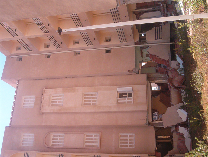 Damage to an apartment building with a soft first story near Algiers, Algeria