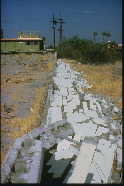 Collapsed Concrete Block Fence