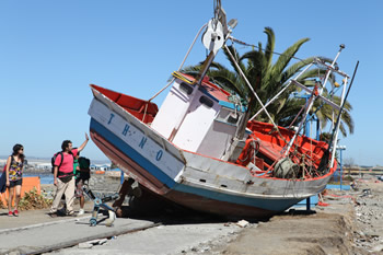 Boat carried onto land by a tsunami at Concepcion Harbor (Talcahuano)